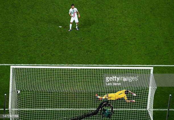 Iker Casillas of Spain saves a penalty from Joao Moutinho of Portugalduring the UEFA EURO 2012 semi final match between Portugal and Spain at Donbass...