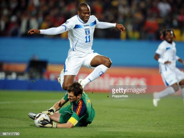 Iker Casillas of Spain saves at the feet of David Suazo of Honduras during a FIFA World Cup Group H match at Ellis Park on June 21 2010 in...