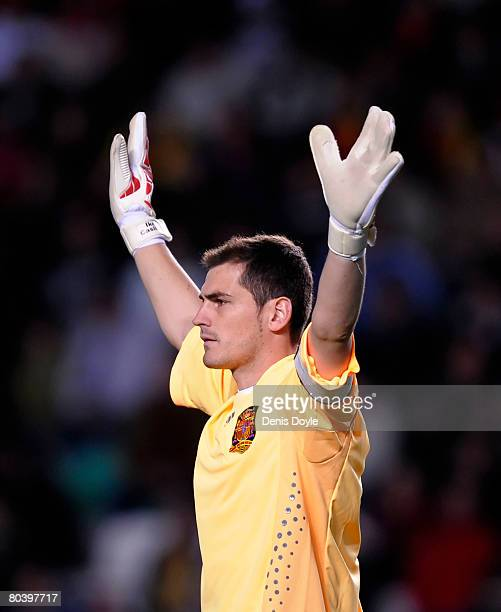 Iker Casillas of Spain signals to teammates during the friendly International soccer match between Spain and Italy at the Martinez Valero stadium on...