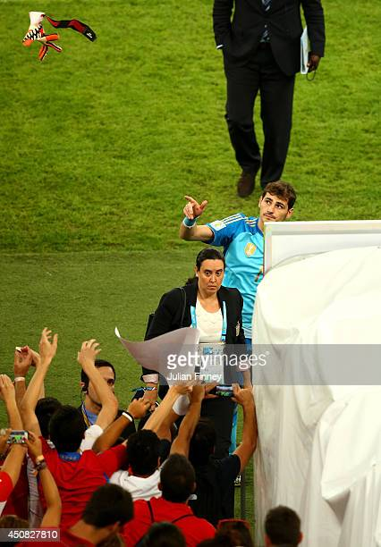 Iker Casillas of Spain throws his glove to fans as he walks off the pitch after a 20 defeat in the 2014 FIFA World Cup Brazil Group B match between...
