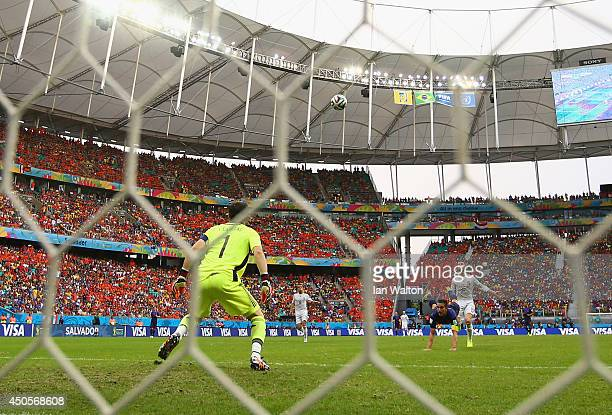 Iker Casillas of Spain watches as a header from Robin van Persie of the Netherlands goes over his head for a goal in the first half during the 2014...