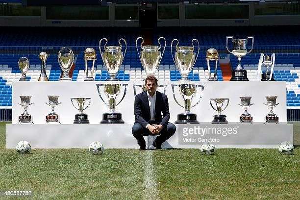 Iker Casillas poses in front of trophies he has won during his career in Real Madrid after holding a press conference to announce that he will be...