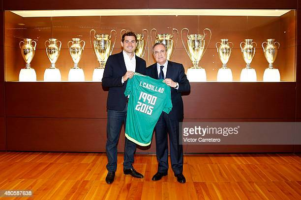 Iker Casillas poses with Real Madrid president Florentino Perez before a press conference to announce that Iker Casillas will be leaving Real Madrid...