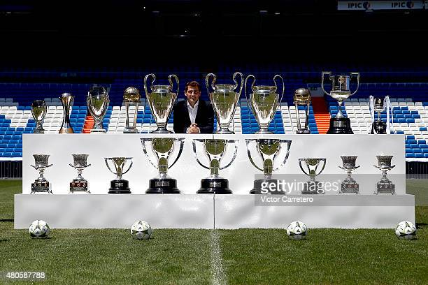 Iker Casillas poses with trophies he has won during his career in Real Madrid after holding a press conference to announce that he will be leaving...