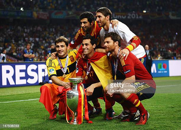 Iker Casillas, Raul Albiol, Alvaro Arbeloa, Sergio Ramos and Xabi Alonso of Spain celebrate with the trophy following victory in the UEFA EURO 2012...
