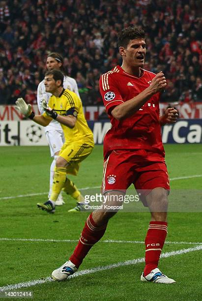 Iker Casillas Sergio Ramos of Real Madrid look dejected and Mario Gomez of Bayern celebrates the second goal during the UEFA Champions League Semi...