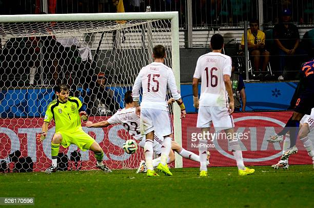 Iker Casillas stops the ball kicked by Georginio Wijnaldum at the 2014 World Cup match between Spain and Netherlands in Salvador Brasil this friday...