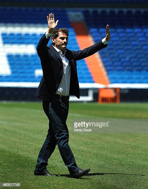 Iker Casillas waves to fans at the Santiago Bernabeu stadium after attending a press conference to announce that he will be leaving Real Madrid...