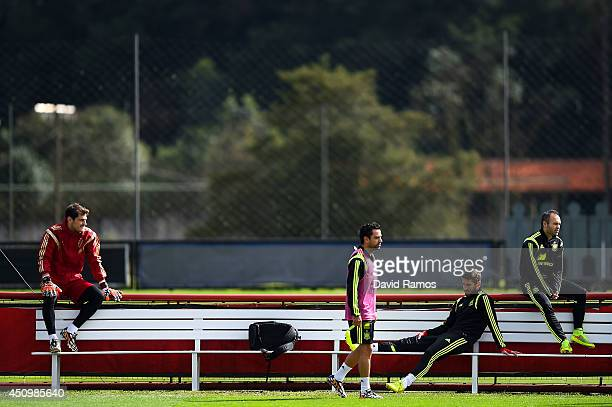 Iker Casillas Xavi Hernandez Sergio Ramos and Andres Iniesta of Spain look on during a Spain training session at Centro de Entrenamiento do Caju on...