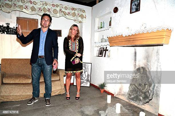Iker Jimenez and Carmen Porter pose at the Belmez replica house during the Cuarto Milenio The Exhibiton at Coliseum theater in Barcelona on September...