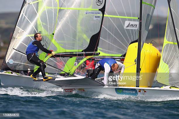 Iker Martinez de Lizarduy and Xabier FernandezGaztanaga of Spain in action during a 49er Class race during day seven of the Weymouth and Portland...