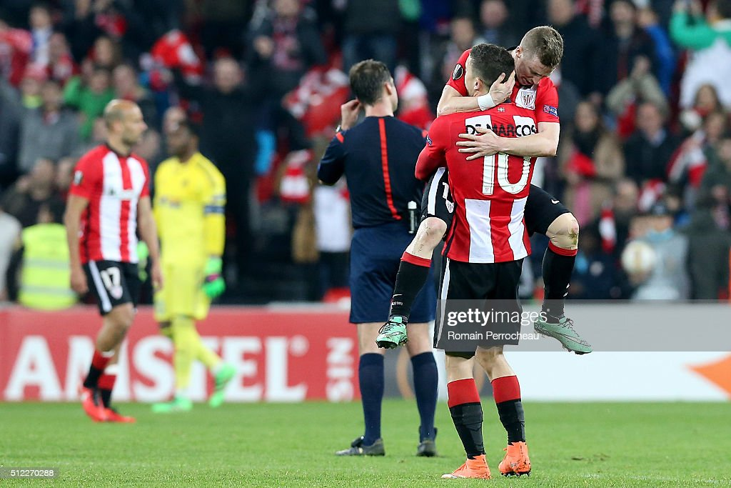 Iker Muniain and Angel De Marcos for Bilbao react after the UEFA Europa League Football round of 32 second leg match between Athletic Bilbao and Olympique de Marseille at San Mames on February 25, 2016 in Bilbao, Spain.