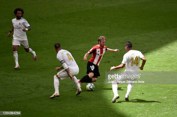 Iker Muniain of Athletic Bilbao battles for possession with Sergio Ramos of Real Madrid and Casemiro of Real Madrid during the La Liga match between...