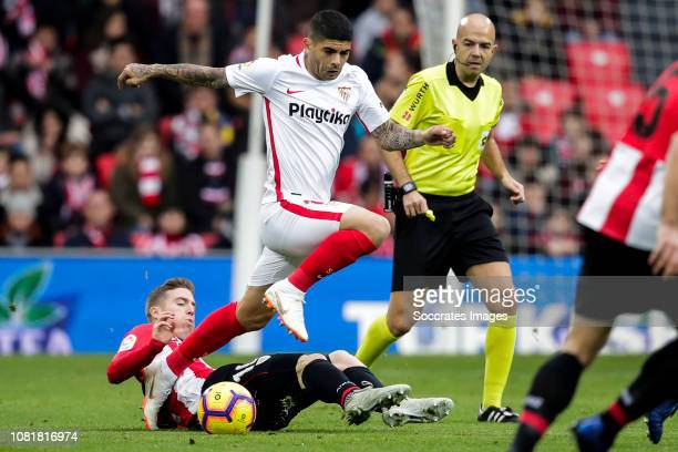 Iker Muniain of Athletic Bilbao Ever Banega of Sevilla FC during the La Liga Santander match between Athletic de Bilbao v Sevilla at the Estadio San...