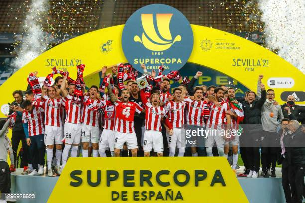 Iker Muniain of Athletic Bilbao lifts the Supercopa de Espana trophy as he celebrates victory with his team mates after the Supercopa de Espana Final...