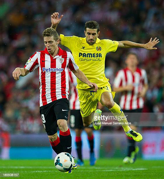 Iker Muniain of Athletic Club Bilbao competes for the ball with Ruben Garcia Cani of Villarreal during the La Liga match between Athletic Club Bilbao...