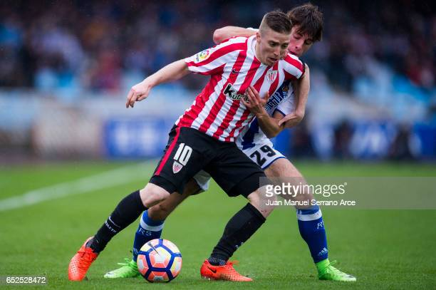 Iker Muniain of Athletic Club Bilbao duels for the ball with Alvaro Odriozola of Real Sociedad during the La Liga match between Real Sociedad de...