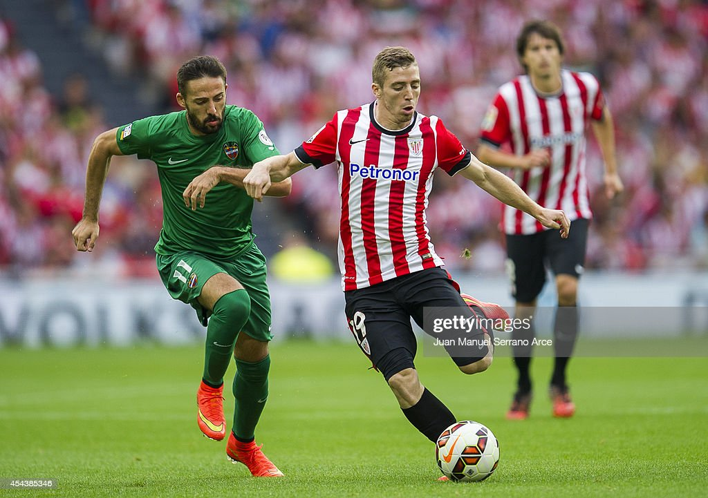 Iker Muniain of Athletic Club Bilbao duels for the ball with Jose Luis Morales of Levante UD the La Liga match between Athletic Club and Levante UD at San Mames Stadium on August 30, 2014 in Bilbao, Spain.