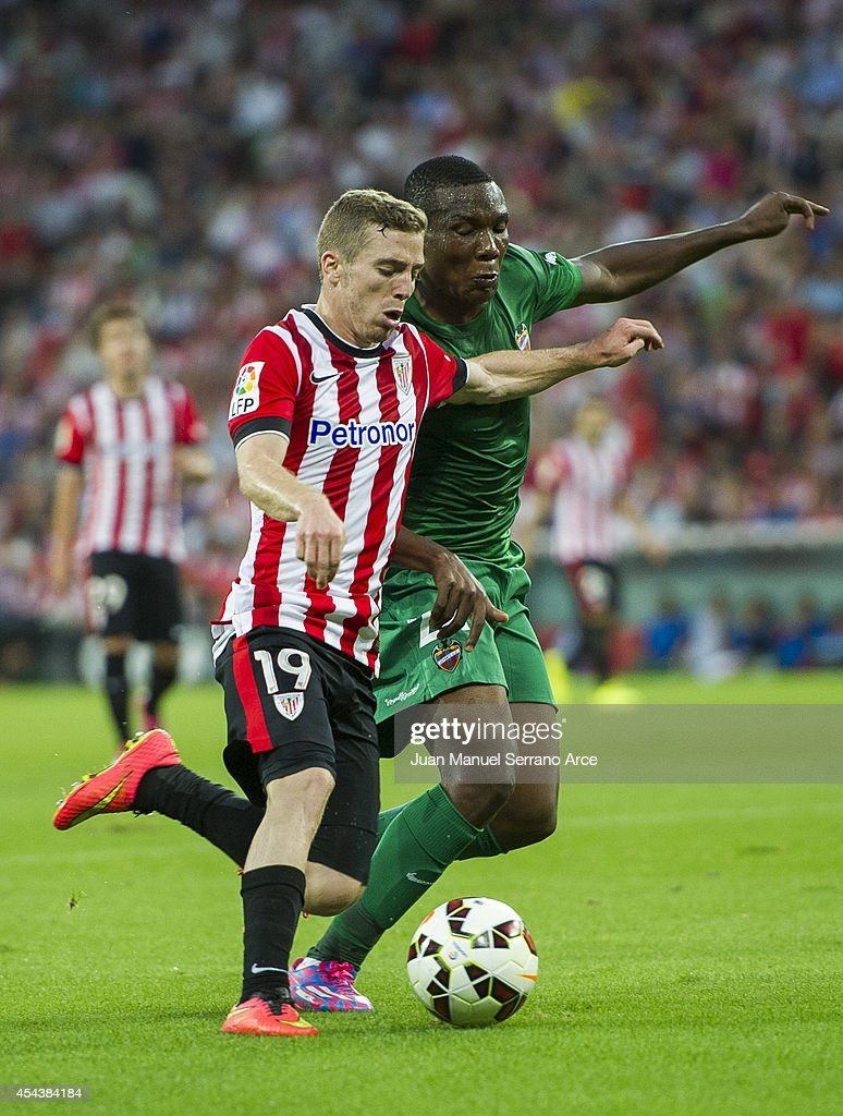 Iker Muniain of Athletic Club Bilbao duels for the ball with Simao Mate of Levante UD the La Liga match between Athletic Club and Levante UD at San Mames Stadium on August 30, 2014 in Bilbao, Spain.