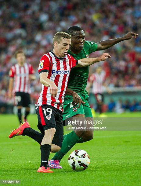 Iker Muniain of Athletic Club Bilbao duels for the ball with Simao Mate of Levante UD the La Liga match between Athletic Club and Levante UD at San...
