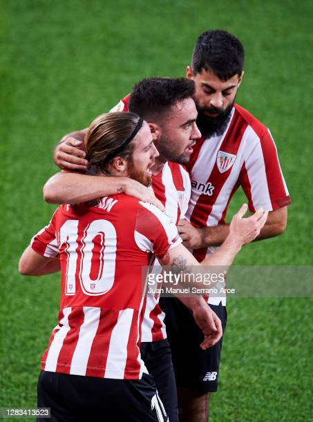 Iker Muniain of Athletic Club celebrates with his teammate Unai Lopez of Athletic Club after scoring the opening goal during the La Liga Santander...