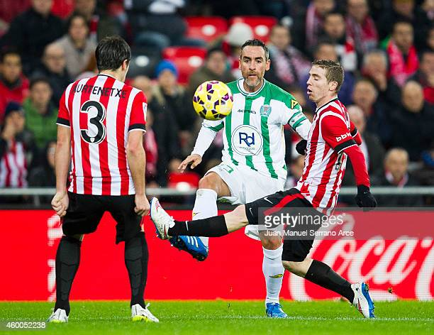 Iker Muniain of Athletic Club duels for the ball with Abel Gomez of Cordoba CF during the La Liga match between Athletic Club and Cordoba CF at San...