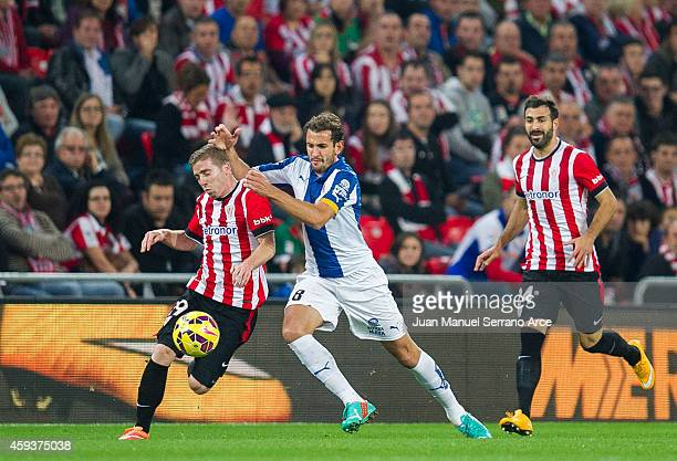 Iker Muniain of Athletic Club duels for the ball with Cristhian Stuani of RCD Espanyol during the La Liga match between Athletic Club and RCD...