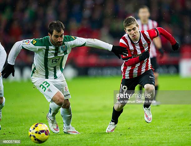 Iker Muniain of Athletic Club duels for the ball with Eduard Campadabal of Cordoba CF during the La Liga match between Athletic Club and Cordoba CF...