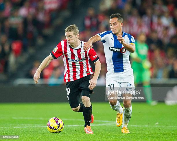 Iker Muniain of Athletic Club duels for the ball with Lucas Vazquez of RCD Espanyol during the La Liga match between Athletic Club and RCD Espanyol...