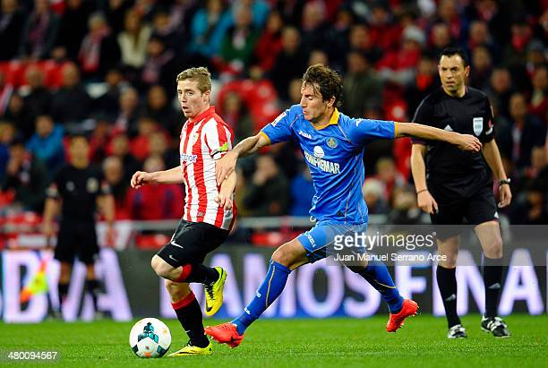 Iker Muniain of Athletic Club duels for the ball with Pedro Mosquera of Getafe CF during the La Liga match between Athletic Club and Getafe CF at San...