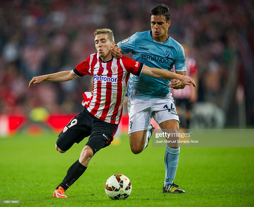 Iker Muniain of Athletic Club duels for the ball withDaniel Garcia of SD Eibar during the La Liga match between Athletic Club and SD Eibar at San Mames Stadium on September 27, 2014 in Bilbao, Spain.