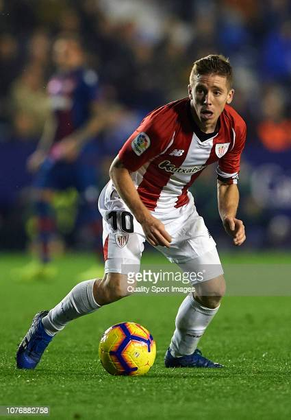 Iker Muniain of Athletic Club runs with the ball during the La Liga match between Levante UD and Athletic Club at Ciutat de Valencia on December 03...
