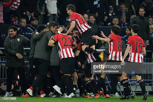 Iker Muniain of Bilbao celebrates with teammates after scoring his team's fourth goal during the UEFA Europa Leauge quarter final first leg match...