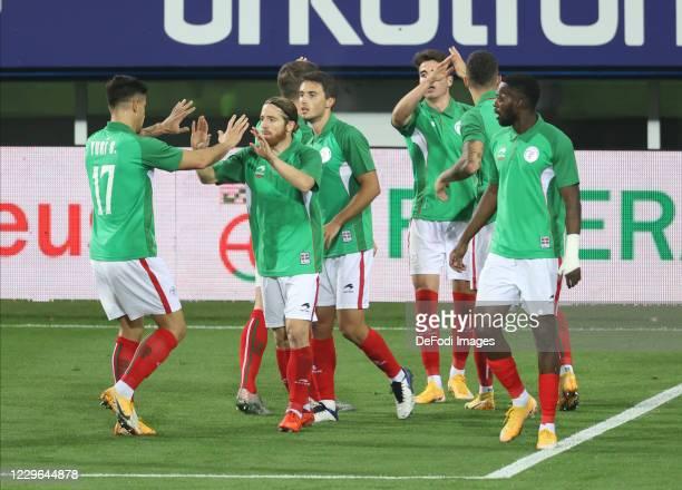 Iker Muniain of Euskal Selekzioa celebrates after scoring his team's first goal with team mates during the international friendly match between...