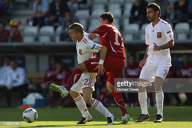 Iker Muniain of Spain holds off Marek Suchy as Adrian looks on during the UEFA European Under21 Championship Group B match between Czech Republic and...