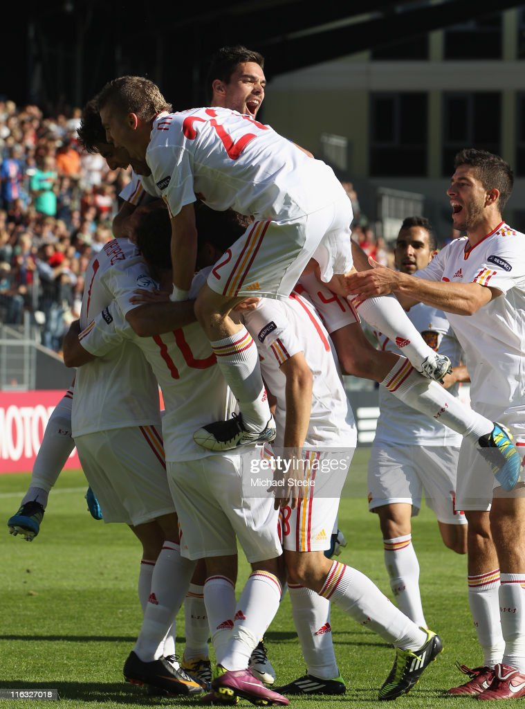 Iker Muniain (C) of Spain jumps on his team mates to celebrate the first goal scored by Adrian during the UEFA European Under-21 Championship Group B match between Czech Republic and Spain at the Viborg Stadium on June 15, 2011 in Viborg, Denmark.