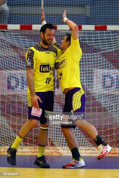 Iker Romero Fernandez and Bartolomiej Jaszka of Berlin celebrate the 3124 victory after the DKB Handball Bundesliga match between TUSEM Essen and...