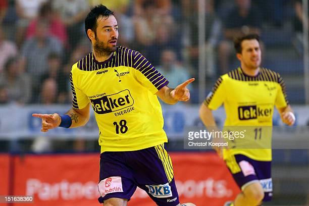 Iker Romero Fernandez of Berlin celebrates a goal during the DKB Handball Bundesliga match between TUSEM Essen and Fueches Berlin at the Sportpark Am...