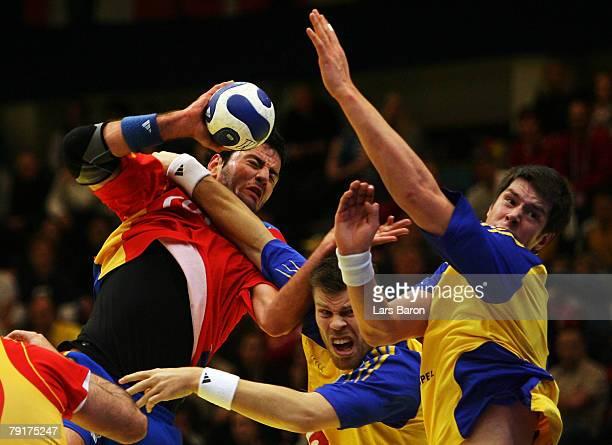 Iker Romero of Spain in action with Robert Arrhenius and Markus Ahlm of Sweden during the Men's Handball European Championship main round Group II...