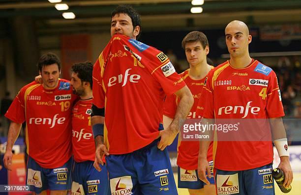 Iker Romero of Spain looks dejected next to his team mates after loosing the Men's Handball European Championship main round Group II match between...
