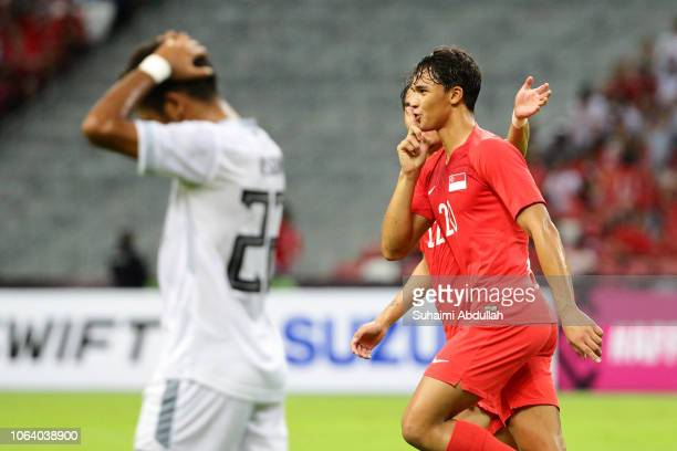 Ikhsan Fandi Ahmad of Singapore reacts after scoring a goal during the AFF Suzuki Cup Group B match between Singapore and TimorLeste at the National...