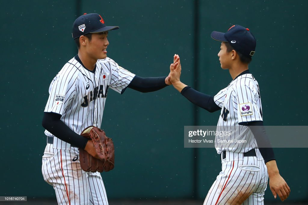 Ikinasuke Fujimori #19 of Japan celebrates with Ryoma Ikeda #5 of Japan during the WBSC U-15 World Cup Group B match between Australia and Japan at Estadio Rico Cedeno on August 10, 2018 in Chitre, Panama.
