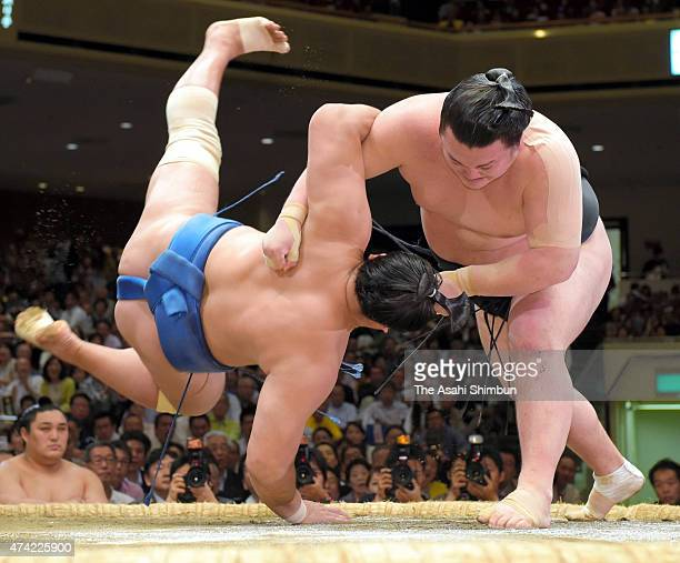 Ikioi throws Mongolian wrestler Kyokushuho during day twelve of the Grand Sumo Summer Tournament at Ryogoku Kokugikan on May 21 2015 in Tokyo Japan
