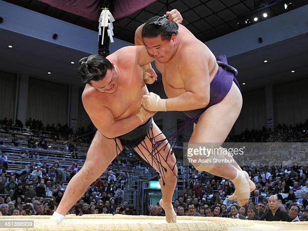 Ikioi throws Mongolian wrestler Shotenro whose real name is Dagdandorjiin Nyamsuren to win during the day eleven of the Grand Sumo Kyushu Tournament...