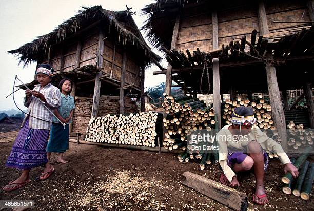 Iko children outside their bamboo huts in the village of Ban Long Muay a two day walk from Muang Sing in Northern Laos The Iko hilltribe people can...