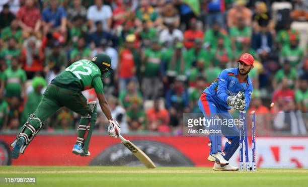 Ikram Ali Khil of Afghanistan attempts to run out Mohammad Saifuddin of Bangladesh during the Group Stage match of the ICC Cricket World Cup 2019...