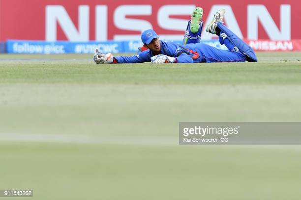 Ikram Ali Khil of Afghanistan reacts after missing a catch during the ICC U19 Cricket World Cup Semi Final match between Australia and Afghanistan at...