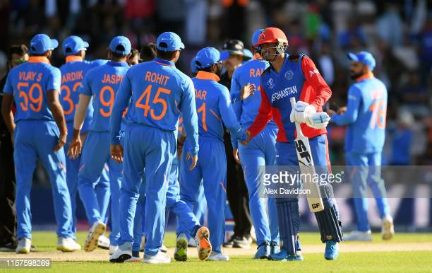 Ikram Ali Khil of Afghanistan shakes hands with the India team during the Group Stage match of the ICC Cricket World Cup 2019 between India and...