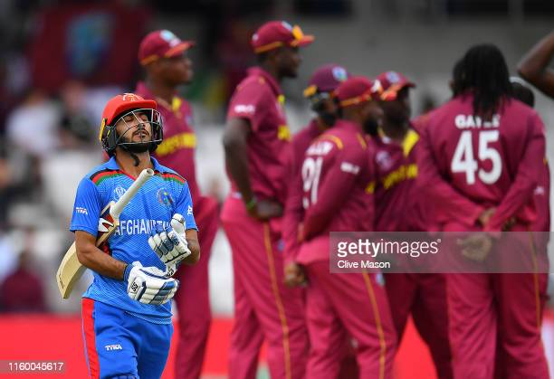 Ikram Ali Khil of Afghanistan walks off after being dismissed by Chris Gayle of West Indies during the Group Stage match of the ICC Cricket World Cup...
