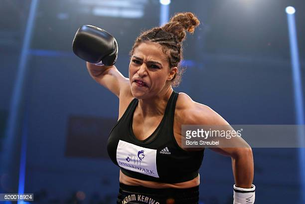 Ikram Kerwat of Germany celebrates after winning the WBC international lightweight championship title fight against Gina Chamie of Hungary at MBS...